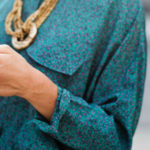 Closeup of woman's hand texting on mobile phone