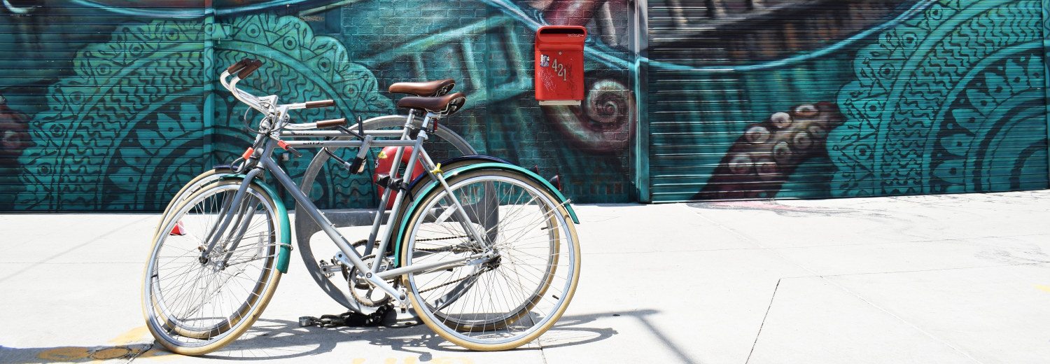Insights Blog Post Header - Bicycle in front of teal mural