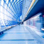 Smart Curation Blog Post - motion-blurred shot of a commuter train pulling into a station