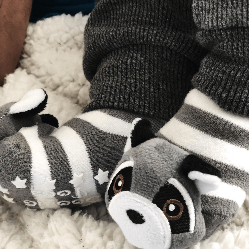 Close up of a baby's feet wearing cute raccoon socks