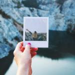 Person holding polaroid photo